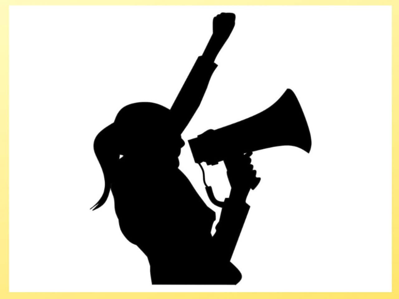拡声器で大声をあげる女性のシルエット