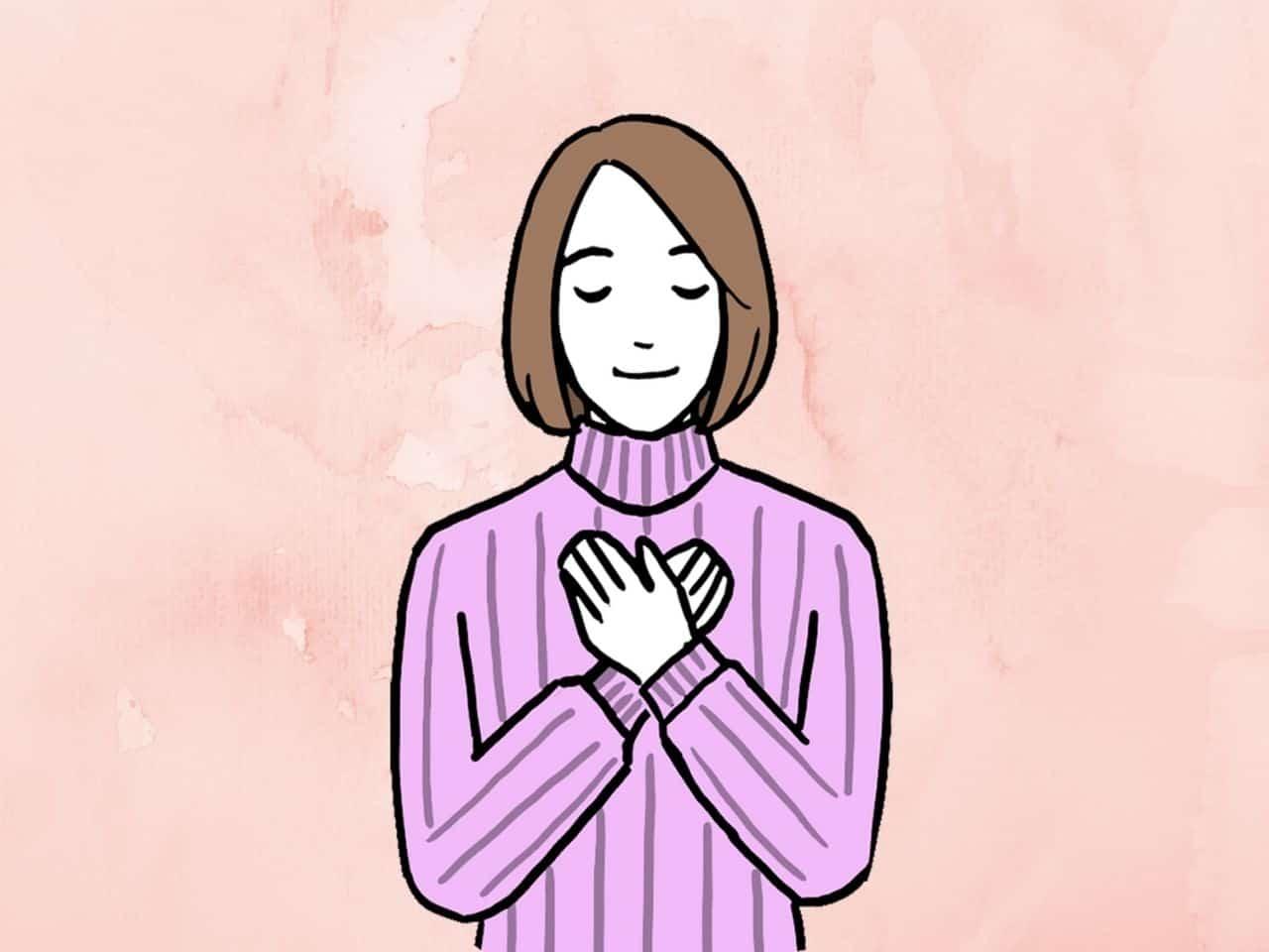両手を胸にあて安心する女性
